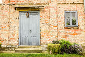 House with old brick wall — Stock Photo