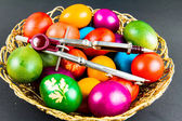 Decorated Easter eggs in a woven basket — Stock Photo