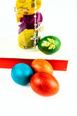 Easter eggs in lab glass with rosary on a holy Bible — Stock Photo