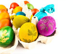 Traditional decorated eggs in carton egg box — Stock Photo