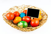 Easter eggs with black board, isoalted on white — Foto Stock
