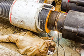Metalworker working on a pipeline  — Stock Photo