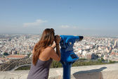 Tourist looking at cityscape — Stock Photo