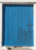Wooden door in Mediterranean house — Stock Photo