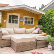 Stock Photo: Garden shed and sofa