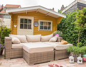 Garden shed and sofa — Stock Photo