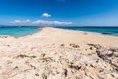 Tourists in Illetes beach Formentera island, Mediterranean sea, — Stock Photo
