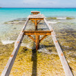 Broken wooden pier Illetes beach Formentera island, Mediterranea — Stock Photo #24524757