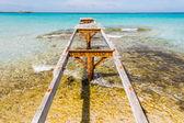 Broken wooden pier Illetes beach Formentera island, Mediterranea — Stock Photo