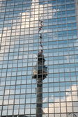 TV tower reflected in glass building — Stok fotoğraf