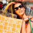 Frau beim Shopping - Stock Photo
