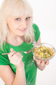 Girl eating healthy salad — Stock Photo