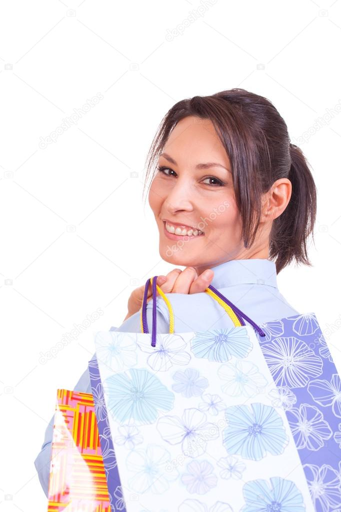 Happy shopping woman holding bags isolated over white. — Stock Photo #14714917