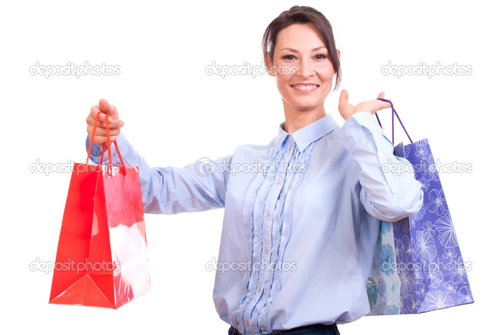Happy shopping woman holding bags isolated over white. — Stock Photo #14715725