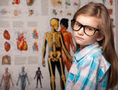 Clever pretty young girl in glasses — Stock Photo