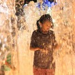 Stock Photo: Childrens at Fountains