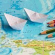 Paper ships on the geography map — Stock Photo