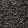 Black pepper background — Stock Photo