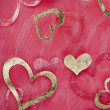 Stock Photo: Hearts on sheer material background
