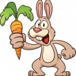 Cartoon bunny holding a carrot - Stock Vector