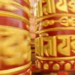 Buddhist prayer wheel rotates - sacred mantra om — Stock Video