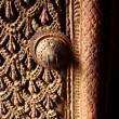 A fragment of a carved wooden door in Kathmandu, Nepal  Godness Sri Kumari house — Stock Photo
