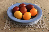Easter eggs on a blue plate — Stock Photo