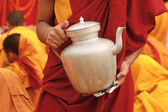 Tibetan tea teapot in the hands of a monk in Nepal — Stock Photo