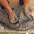 Stock Photo: Man's hands knead clay in Nepal