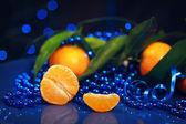 Tangerines on a dark blue background - New Year Mandarins — Stock Photo