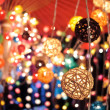 Stock Photo: Colorful garlands at the night market in Thailand