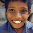 Stock Photo: Indiboy smile in blue shirt - Karnataka, Hampi