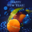 Merry Christmas - New Year Card - Tangerines on a dark blue back — Stock Photo