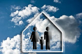 House and family — Stock Photo
