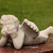 Cherub baby in cemetery - lying down — Stock Photo