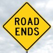 Road sign - road ends in clouds — Stock Photo