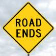 Road sign - road ends in clouds — Stock Photo #12053572