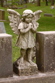 Standing angel with wings in cemetery — Zdjęcie stockowe
