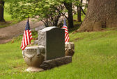 Tombstone with flags — Stock Photo