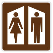 Road sign - brown restrooms — Stock Photo