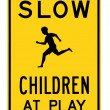 Road sign - slow children at play — Stockfoto