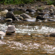 Derby hat on rock in river — Stock Photo #12074973