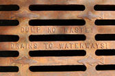 Dump no waste! Drains to waterways — Stock Photo