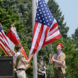 Boy scouts raising the flag — Stock Photo