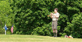 Boy scout plays tap on memorial day — Stock Photo