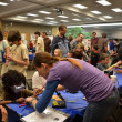 Stock Photo: Learning how to solder at Ann Arbor mini Maker Faire