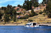 Tourist boat in Amantani on Lake Titicaca — Stock Photo