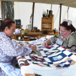 Stockfoto: Civil-war erreenactors quilting
