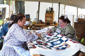 Civil-war era reenactors quilting — Stock Photo
