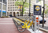Bike Share Indianapolis street view with sign — Stock Photo
